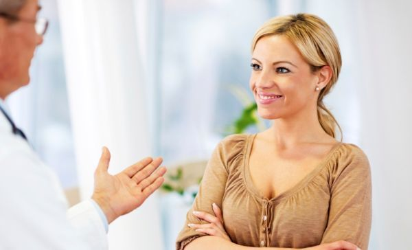 Doctor talking to a female patient.   [url=http://www.istockphoto.com/search/lightbox/9786662][img]http://dl.dropbox.com/u/40117171/medicine.jpg[/img][/url]